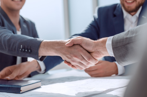 photo of accountant shaking hands with a business owner