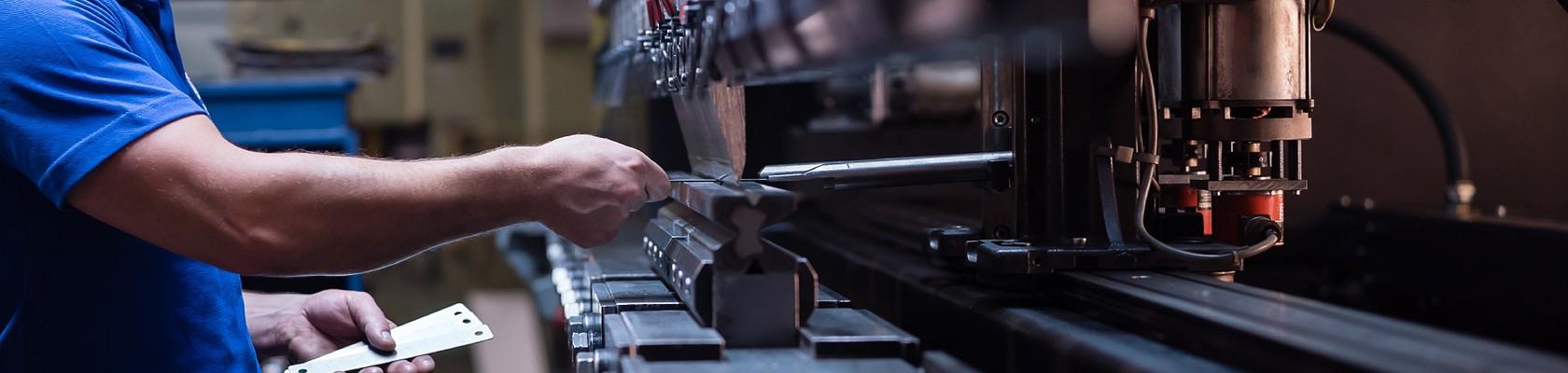 person using manufacturing machine