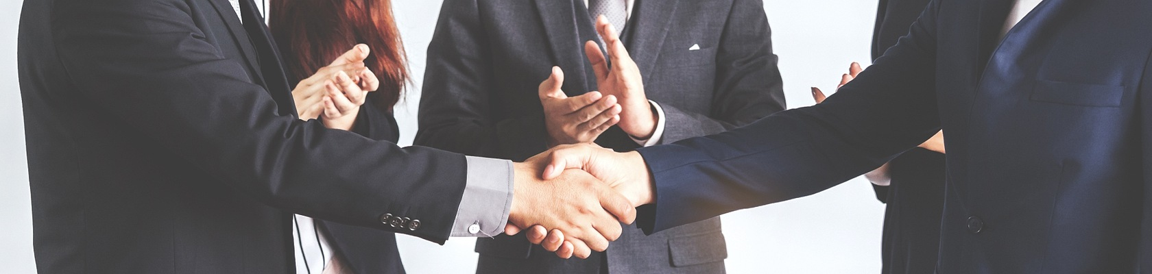 photo of an M&A deal - people shaking hands