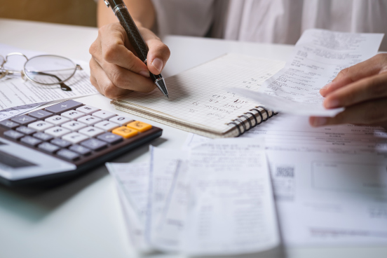 photo of an accountant counting receipts